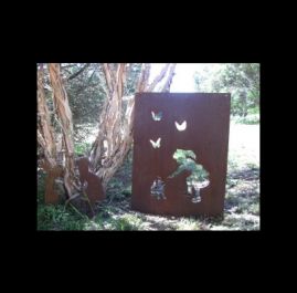 Girl patting cat panel. $150. This Garden ornament panel is 700 x 900mm and made out of 2mm mild steel in Raw or Rust finish.  This Panel can be tailored to suit your needs by inserting wording, altering the size and/or changing images.