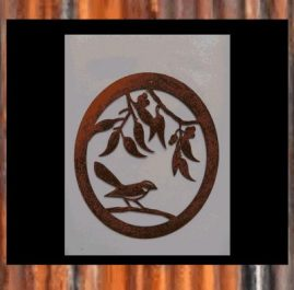 Willy Wagtail in oval. This wall plaque is 430 x 500mm and made out of 2mm mild steel. Rust Finish $70.00 Black Metal Guard paint Finish $85.00   This plaque can also have the addition of 'Welcome' at the top of the frame.