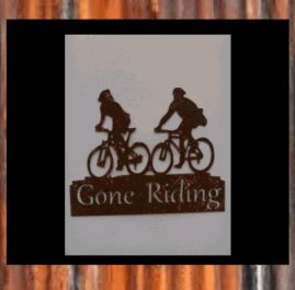 Cyclists. Rust. $55
