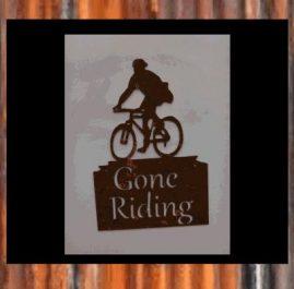Cyclist - boy. Rust $50
