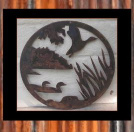 Ducks on circle.  Ducks in Circle Image This wall art is approximately 400 mm diameter Available in Rust $70.00 or Satin Black $85.00