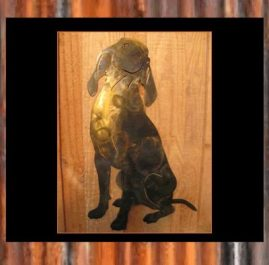 Coonhound sitting. This Wall Plaque is approximately 320 x 500 ml and finished in Gold & Dark Patina $150 Also available in BlackMetal Guard paint $75.00 Raw or Rust $50.00